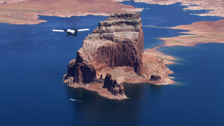 Grand Canyon Scenic Airlines Viking Twin Otter flying over Grand Canyon