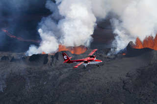 Norland Air Viking Twin Otter flying near volcano