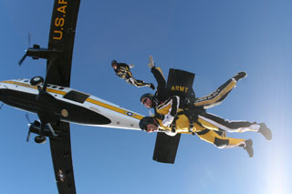 US Army Parachute Team skydiving from Viking Twin Otter