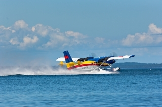 Twin Otter with floats landing on water